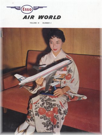 Stewardess of Japan Air Lines hoding a model of a DC-8 in JAL colours.